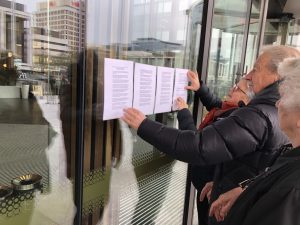 """We Accuse"" statements being placed on doors of Court"
